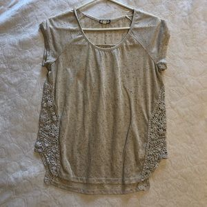 Cream colored top with lace accents